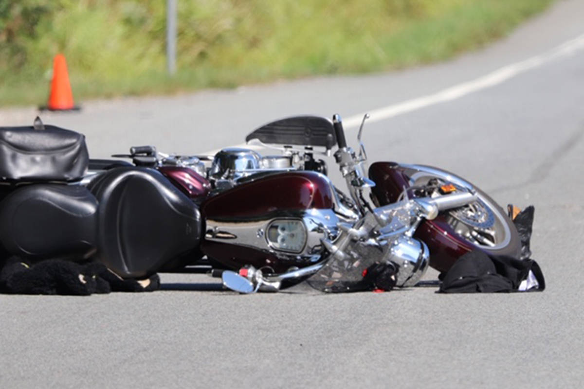 Police had a section of 16 Avenue closed off Thursday afternoon following a collision between a motorcycle and a mini van. The motorcyclist was taken to hospital with undisclosed injuries. (Shane MacKichan photo)