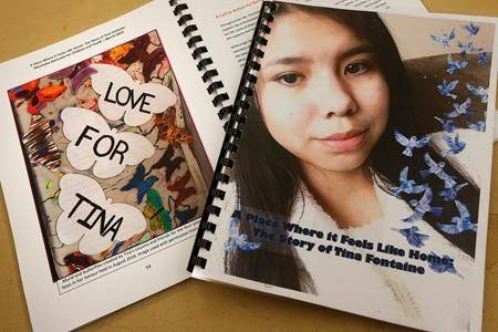 Copies of a special report on the death of fifteen-year-old Tina Fontaine released by Daphne Penrose, the Manitoba Advocate for Children and Youth, are pictured at a release event at the Sagkeeng Mino Pimatiziwin Family Treatment Centre on the Sagkeeng First Nation, Man., Tuesday, March 12, 2019. (THE CANADIAN PRESS/John Woods)