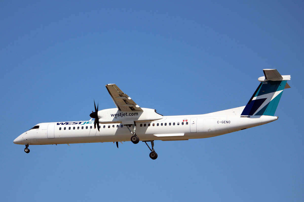 A Bombardier Dash 8 Q400 turboprop operated by WestJet preparing to land at Vancouver International Airport. The airline has announced increased daily service on their Nanaimo-Calgary and Nanaimo-Vancouver routes beginning Aug. 14 and Oct. 28. The additional routes are seasonal and will end in late April. (Nicholas Pescod/NEWS BULLETIN)