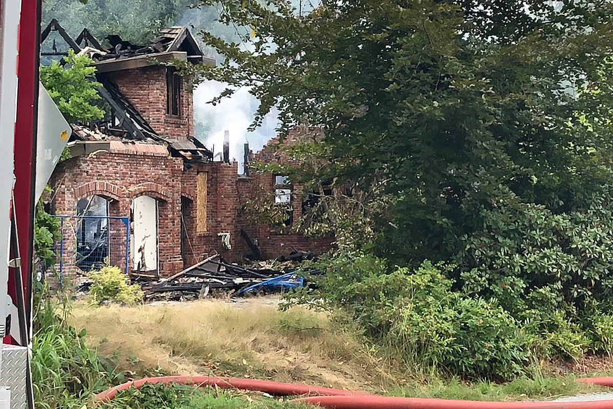 Township firefighter were able to knock down a blaze in an abandoned house in Willoughby early Saturday morning. But not before extensive damage was done. (Laurel Thomas/Special to Black Press Media)