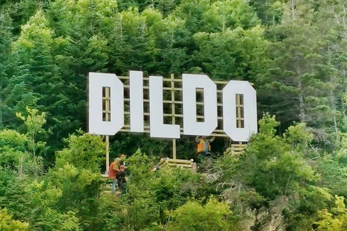 A Hollywood-like sign can be seen over the town of Dildo, Newfoundland in Canada in this undated handout photo provided August 19, 2019. After a Hollywood-like sign went up over Dildo, N.L., thanks to a segment on Jimmy Kimmel Live, town officials are asking people to stop climbing through private property to take photos with it, warning the sign may have to come down. THE CANADIAN PRESS/HO, Marilyn Crotty