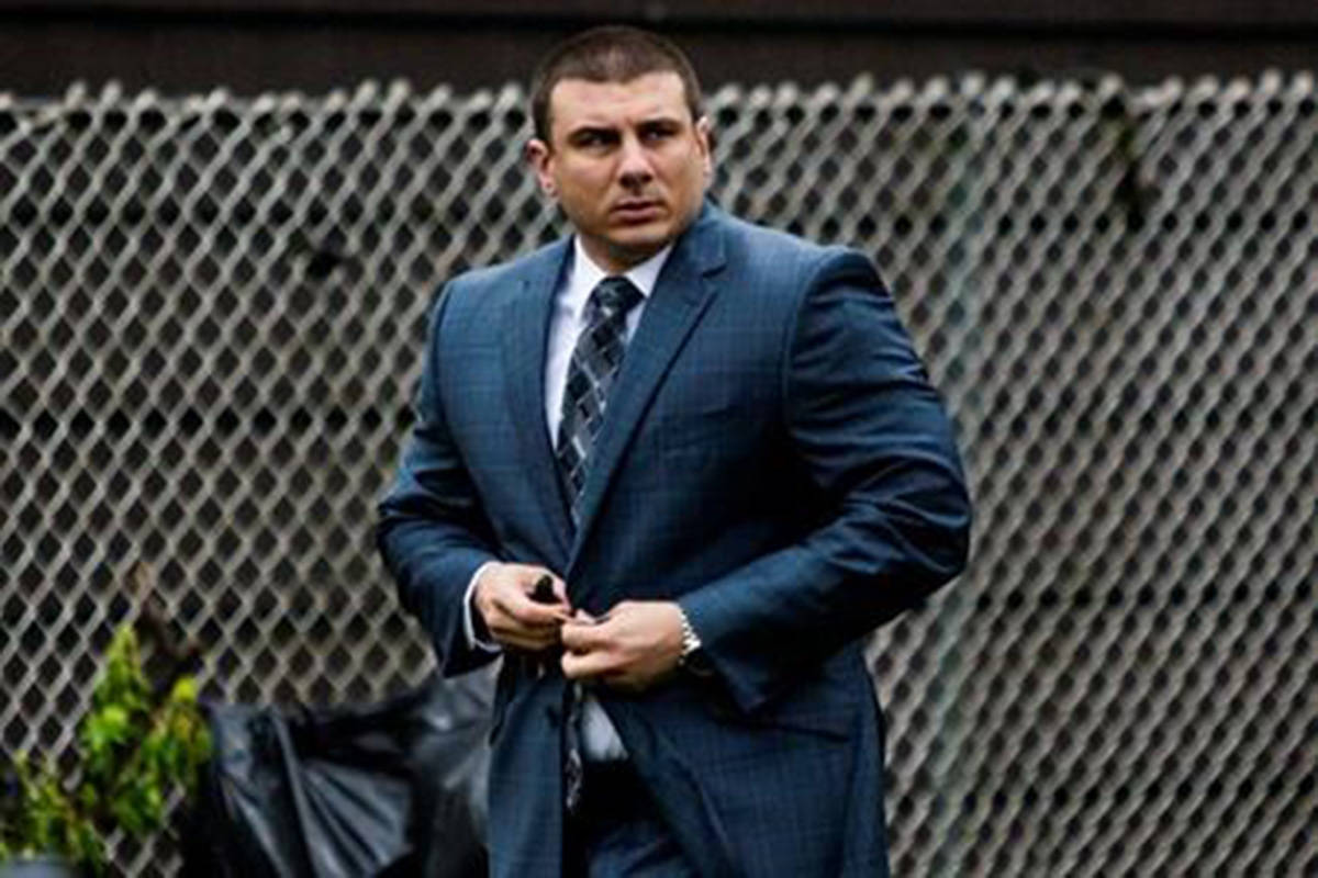 FILE - In this May 13, 2019, file photo New York City police officer Daniel Pantaleo leaves his house Monday, May 13, 2019, in Staten Island, N.Y. New York City's police commissioner has scheduled a midday news conference as the city waits for his decision on whether to fire Pantaleo, a police officer involved in the 2014 death of an unarmed black man. Police commissioner James O'Neill said he would make an announcement at 12:30 p.m. Monday, Aug. 19, on an undisclosed topic. (AP Photo/Eduardo Munoz Alvarez, File)