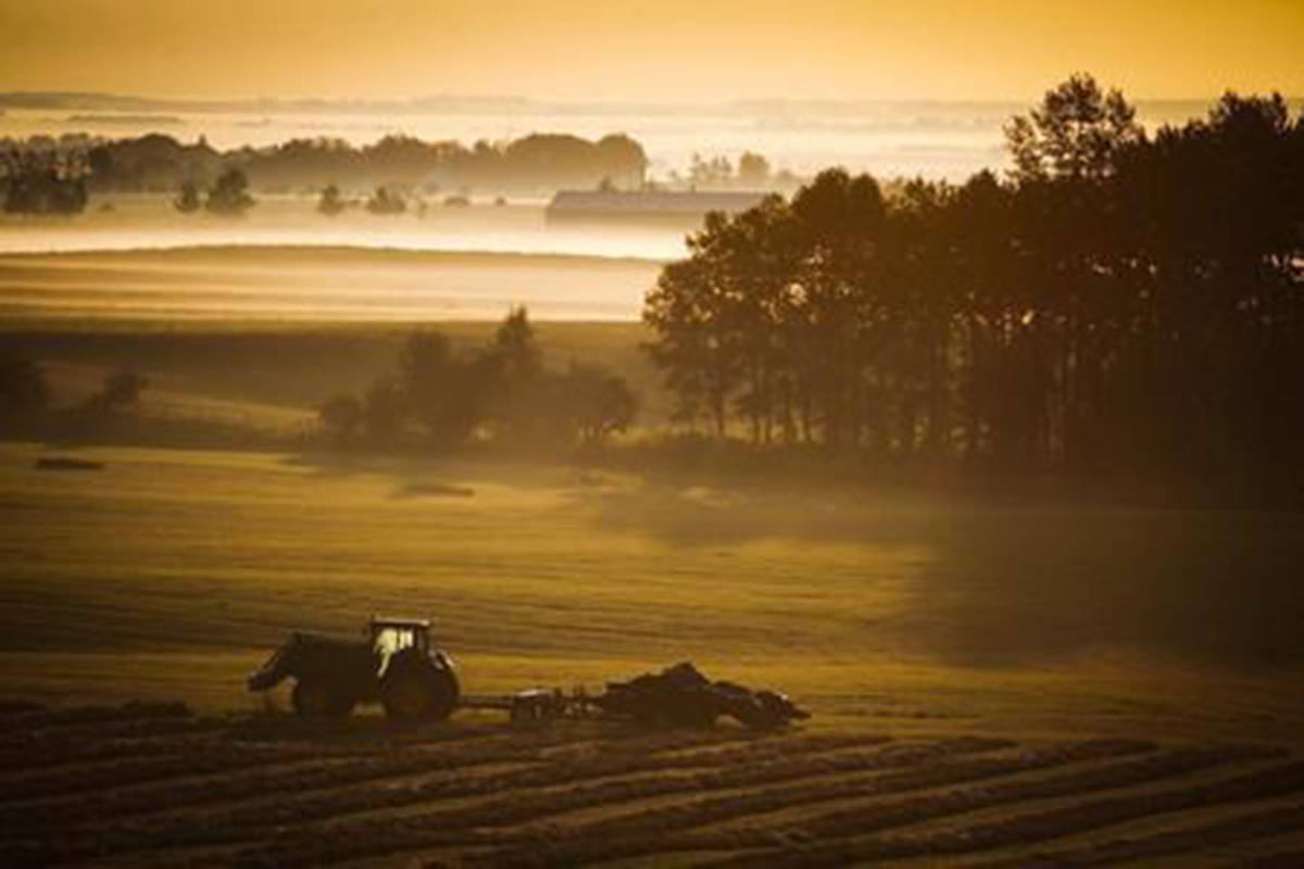 A farm tractor and baler sit in a hay field on a misty morning near Cremona, Alta., Tuesday, Aug. 30, 2016. Canadian farmers are looking to more sustainable farming techniques like capturing carbon in the soil as the warnings grow louder that our food supplies are at risk from climate change and land degradation. Elections Canada says whether discussing the veracity of climate change becomes a partisan issue for third parties during the election will be decided on a case-by-case basis and only if it receives complaints. THE CANADIAN PRESS/Jeff McIntosh