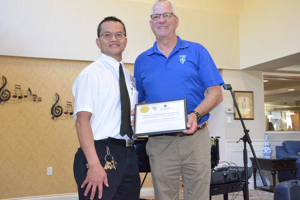 Charlie Lee is with the Walnut Grove IGA and was on hand recently to receive a certificate of appreciation from Township Mayor Jack Froese for qualifying as an age-friendly business. (Heather Colpitts/Langley Advance Times)