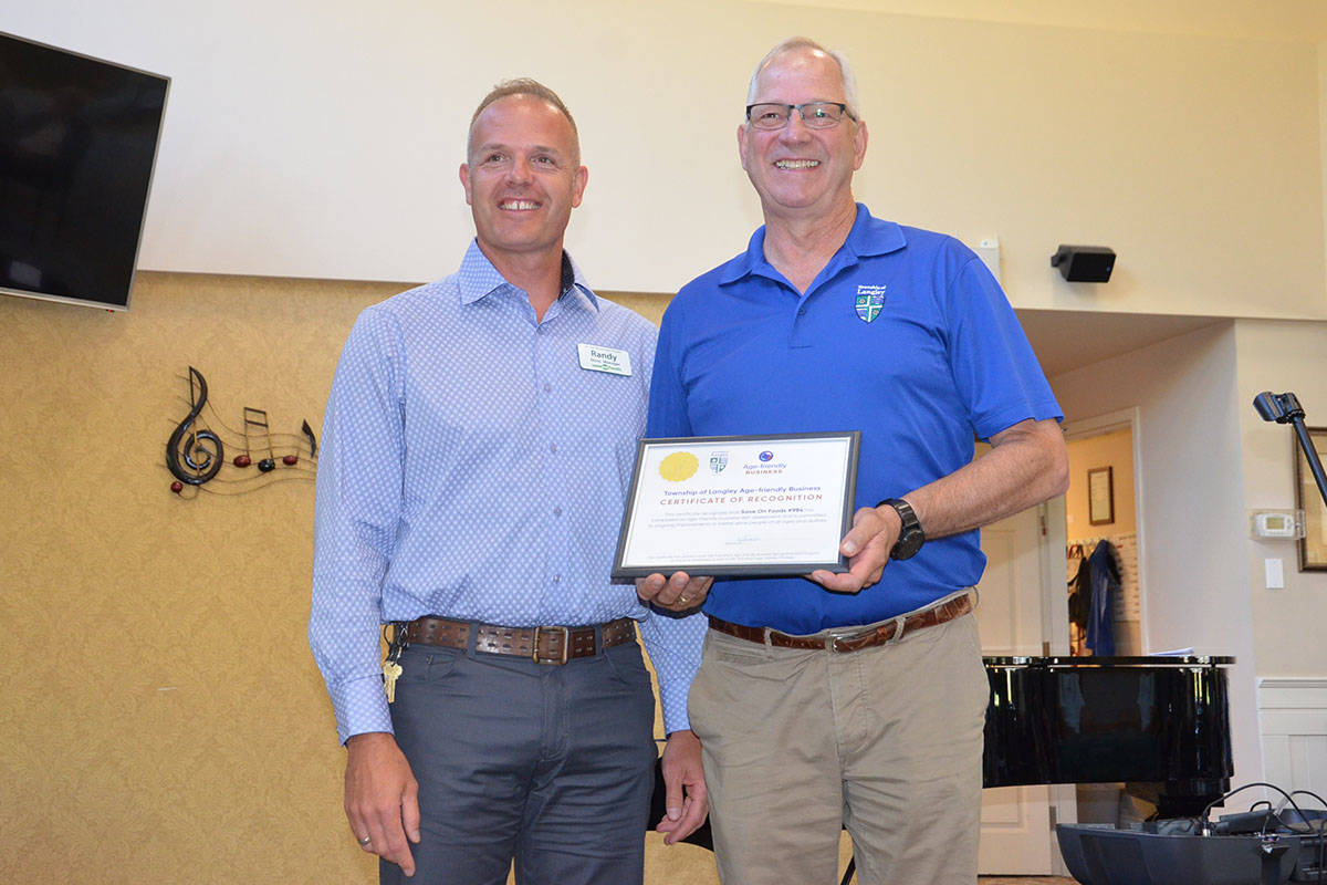 Save-On-Foods Walnut Grove representative Randy Nerling picked up a certificate of appreciation from Township Mayor Jack Froese for being an age-friendly business. (Heather Colpitts/Langley Advance Times)