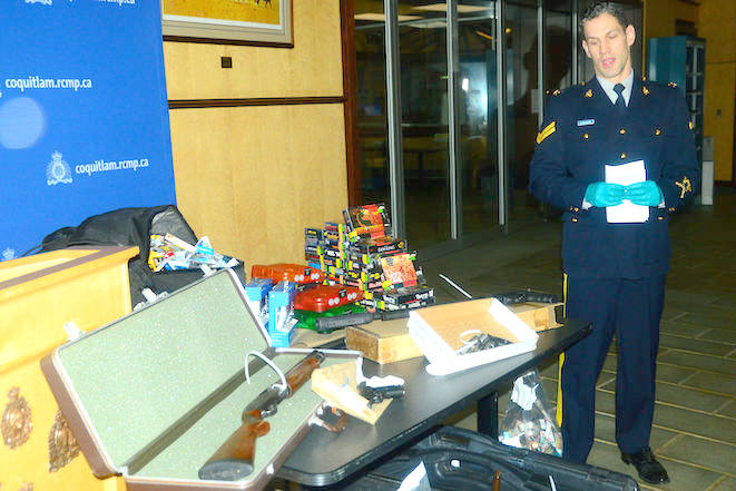 During a 2017 press conference, Coquitlam RCMP Cpl. Michael McLaughlin displayed the items seized in a series of armed robberies across the Lower Mainland.