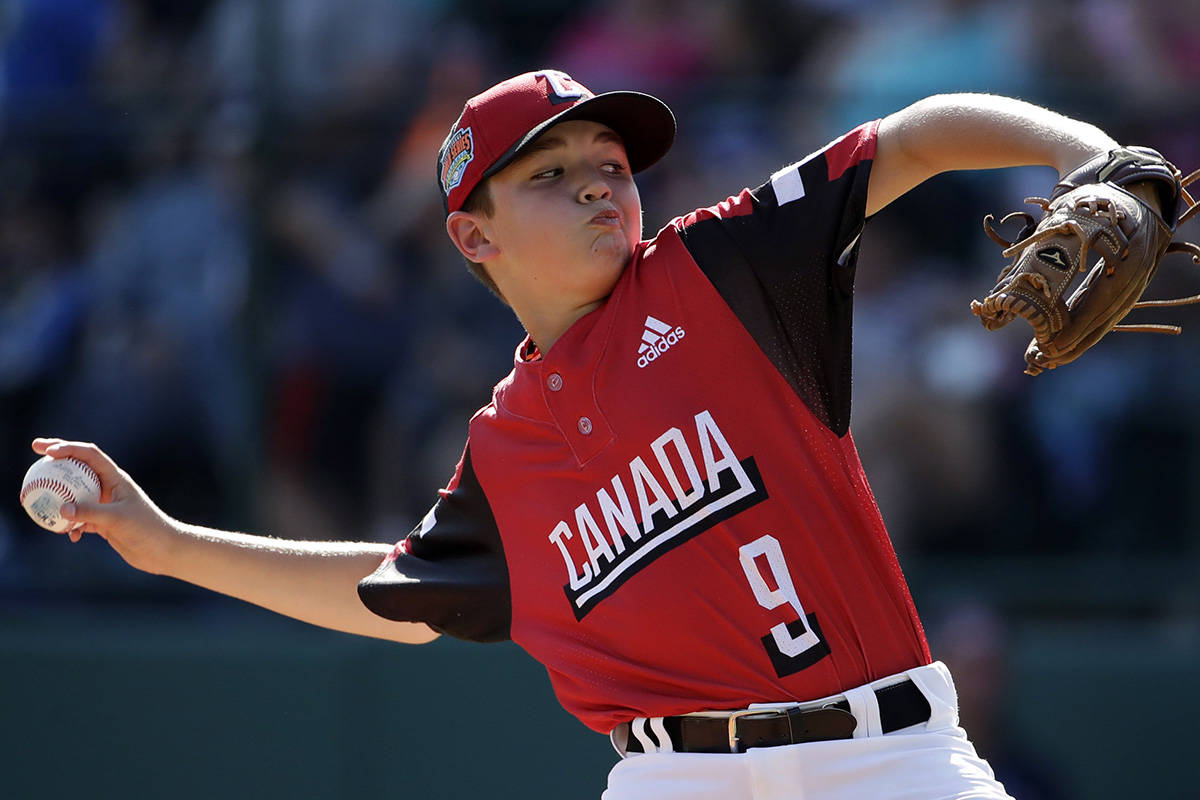 Canada's pitcher Timmy Piasentin delivers during the third inning of an elimination baseball game against Curacao at the Little League World Series tournament in South Williamsport, Pa., Monday, Aug. 19, 2019. (AP Photo/Gene J. Puskar)