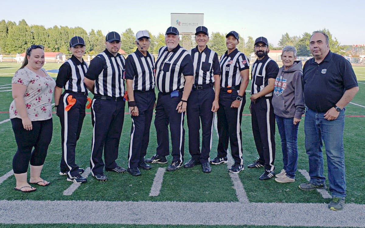 Brittany Anderson (timekeeper), Tracy Paluzzi (head linesman), Tayler Anderson (field judge), Sandy Bains (referee), Rick Carter (umpire), Hans Vanderdoe (side judge), Desiree Abrams (back judge), Clarke Raffin (line judge), Karen Madill (game observer), and Carey Anderson (CFL supervisor of officials) were the officiating team for the game on Aug. 17. (Carey Anderson photo/Special to the Langley Advance)
