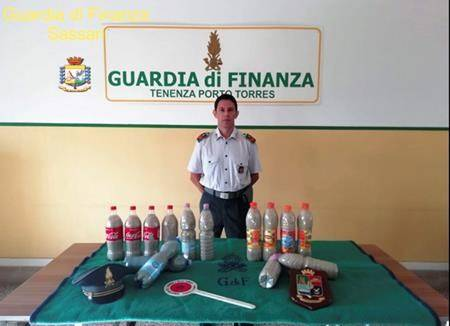 This picture taken on Aug. 16, 2019 and made available Monday, Aug. 20, 2019 by the Finance Police of the Sardinian port of Porto Torres, Italy, shows 14 plastic bottles of sand seized from a French couple in the trunk of the couple's car. (Italian Finance Police via AP)