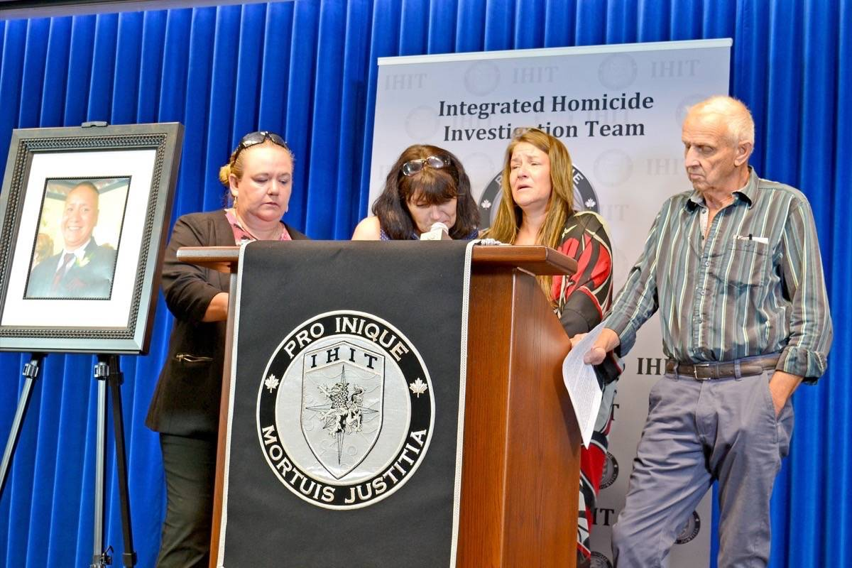 Angela Prestbakmo, the sister of South Surrey stabbing victim Paul Prestbakmo, addresses media Tuesday morning, flanked by friends and family. (Tracy Holmes photo)