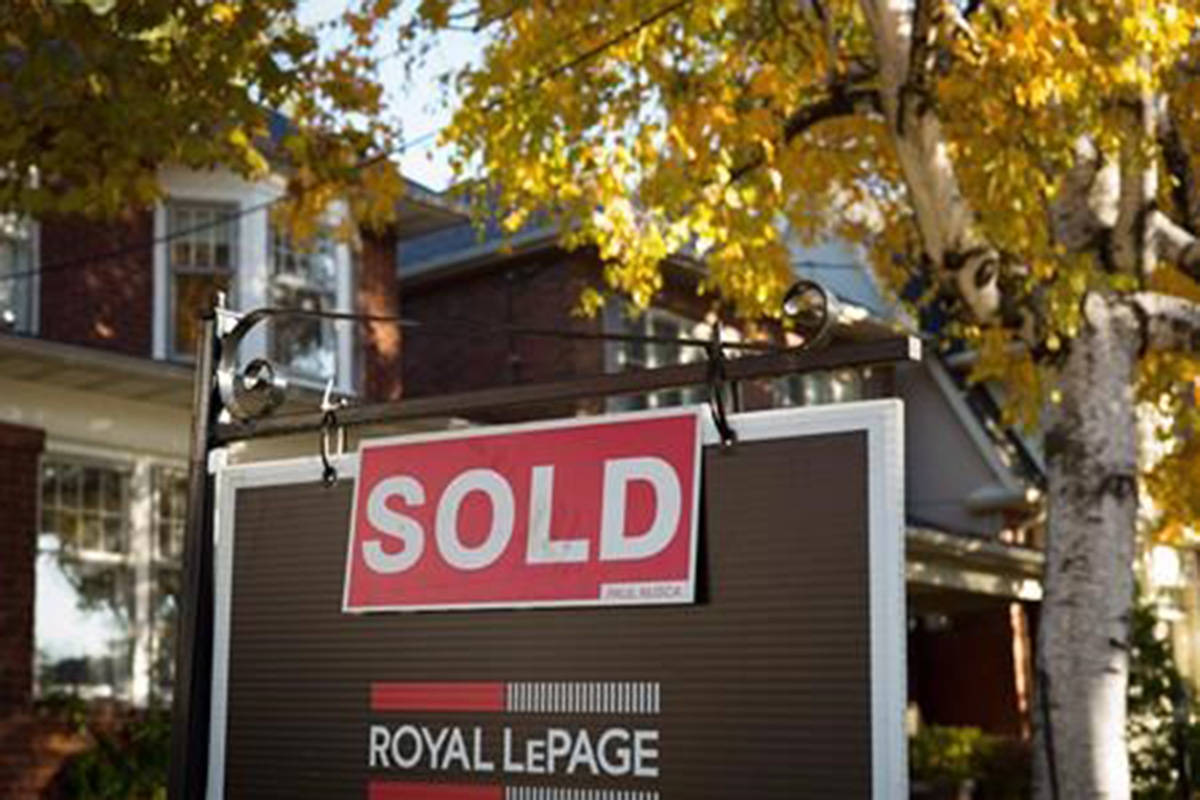 Canadian annual inflation rose by two per cent in July to hit the Bank of Canada's ideal target for a second straight month. The latest consumer price index found higher costs, year-over-year, for auto insurance, mortgage interest and fresh vegetables. A real estate sold sign hangs in front of a west-end Toronto property Friday, Nov. 4, 2016. THE CANADIAN PRESS/Graeme Roy