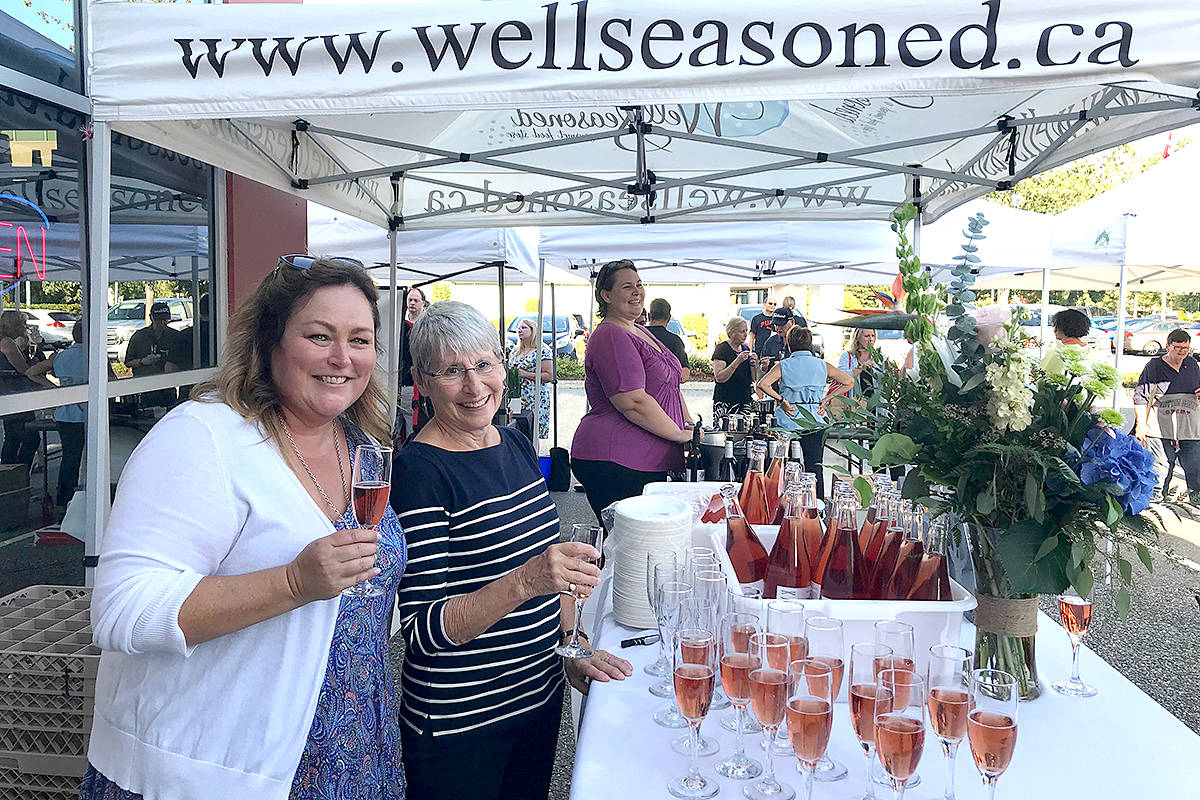 Happy Anniversary: Well Seasoned – a gourmet food store celebrated 15 years with a parking lot party like no other last week. Lovers all things gourmet and local came out and tried delicious local products, visited with vendors, and joined in a toast to mark the milestone with Well Seasoned owner and founder Angie Quaale (left). (Lisa Farquharson/Langley Advance Times)