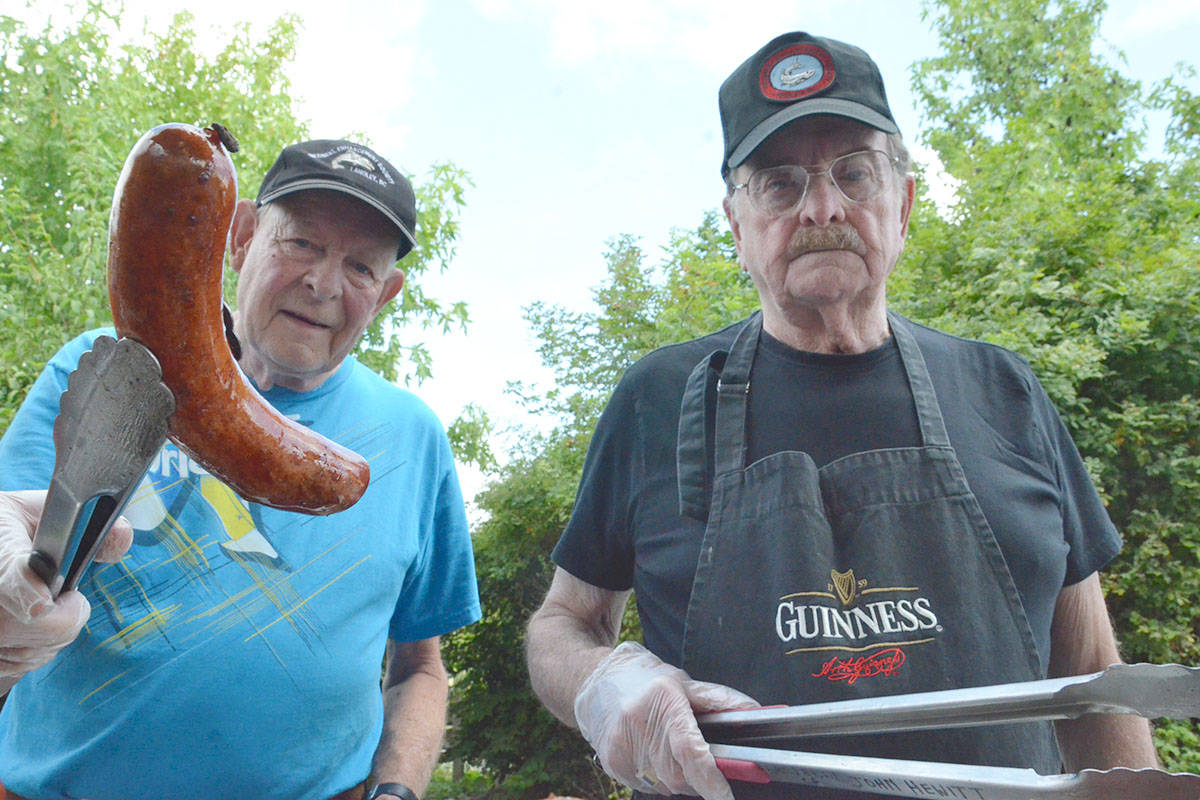 The Nicomekl Enhancement Society returned to the Blackberry Bake-off again this year to offer up a barbecue lunch. Volunteers such as Bob Knudson and John Hewitt were on the grill. (Heather Colpitts/Langley Advance Times)