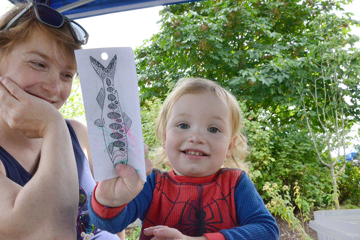 Roland Hackault, with his mom, Nicola Van Der Laars, tried out the crafts during the Blackberry Bake-off on Thursday. (Heather Colpitts/Langley Advance Times)