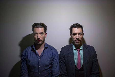 """Jonathan Scott, left, and Drew Scott pose for a photo as they promote the new television series """"Property Brothers at Home"""" in Toronto on Tuesday, Nov. 4, 2014. THE CANADIAN PRESS/Chris Young"""