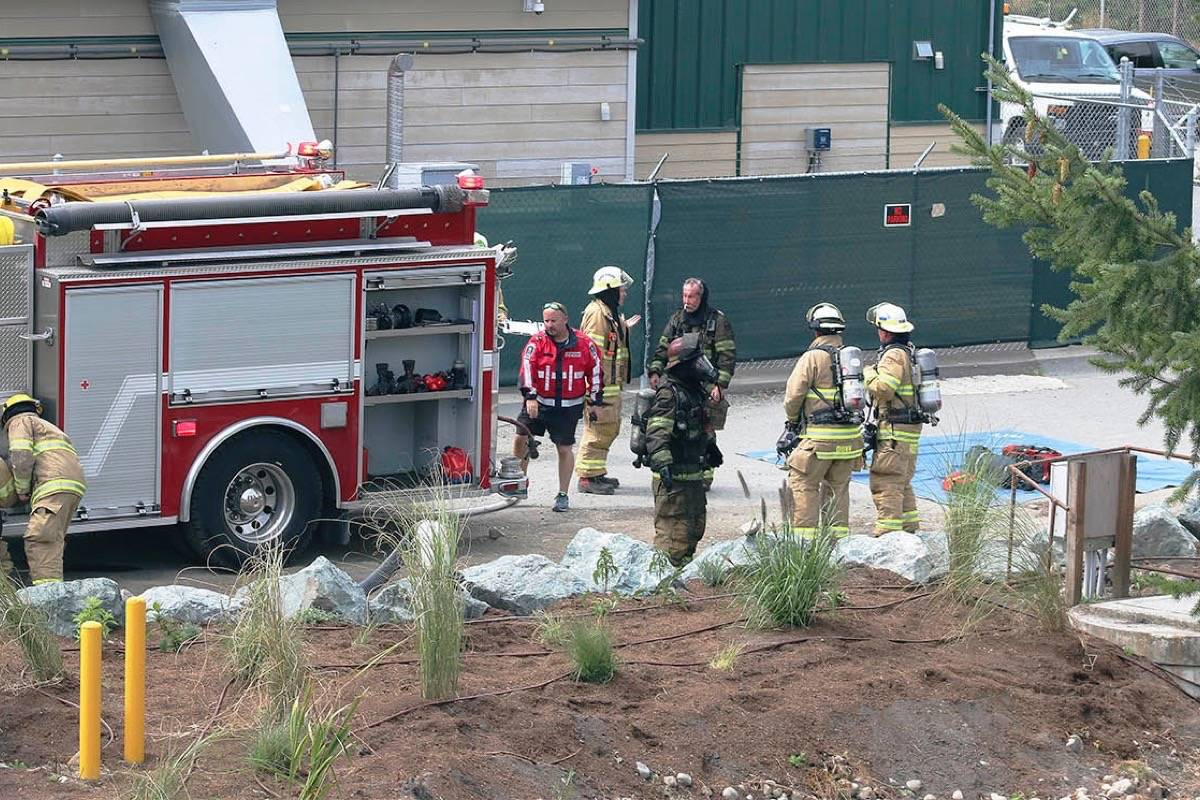 Firefighter Douglas gets hosed down after being inside the burning warehouse Tuesday afternoon. (Sarah Simpson/Citizen)