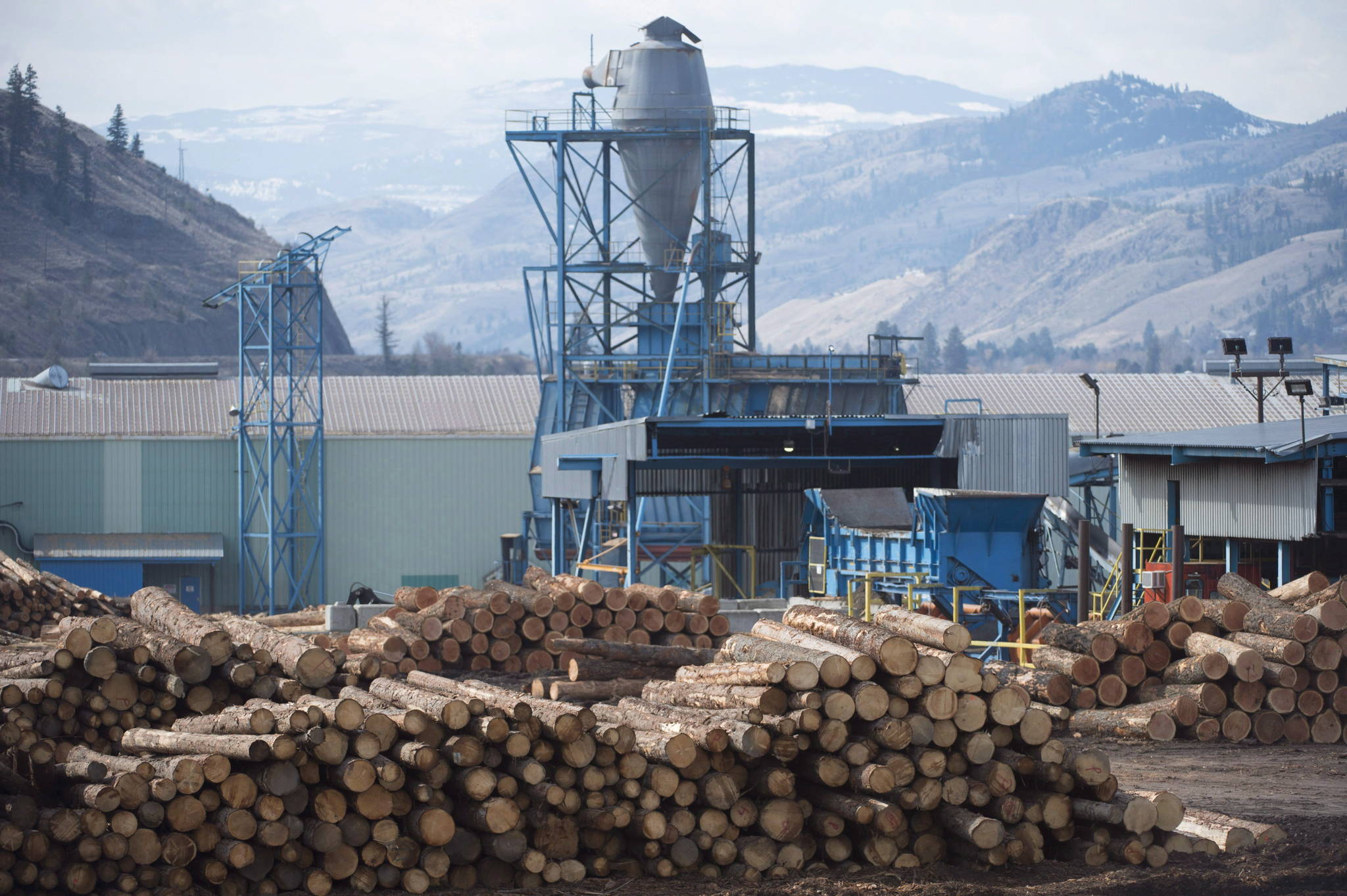 An energetic rally by workers in the north-central British Columbia community of Mackenzie has highlighted the desperate situation facing many forestry-dependent communities across the province. Softwood lumber is pictured at Tolko Industries in Heffley Creek, B.C., Sunday, April, 1, 2018. Three wood products operations in Mackenzie closed indefinitely or cut back hours this summer, blaming high log costs and adverse market conditions. THE CANADIAN PRESS/Jonathan Hayward