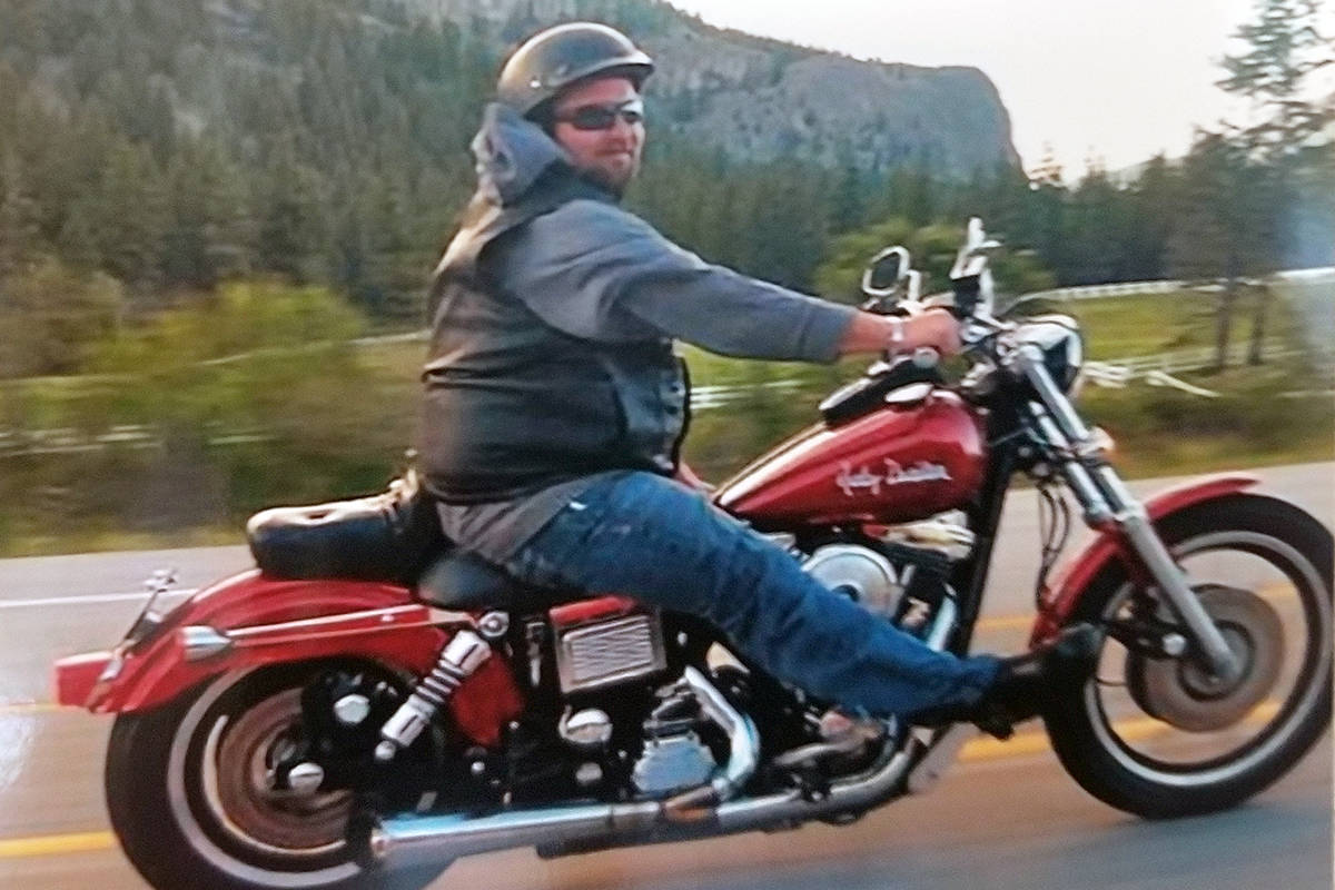One of many photos at a celebration of life for Shaun Nugent showed him during one of his favourite activities, riding his motorcycle. (Courtesy Nugent family)