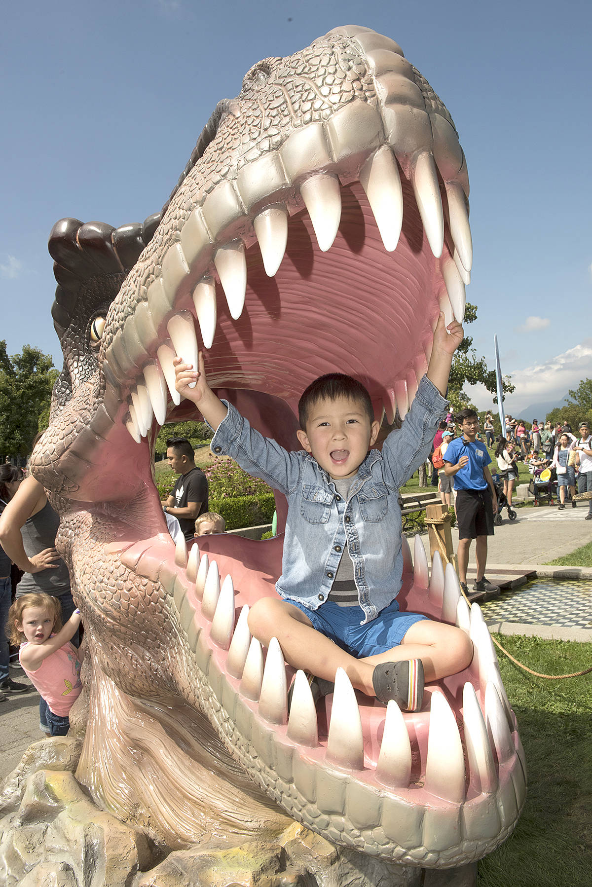 Say cheese: Three-year-old Hugo Simon of Langley posed inside the mouth of a T-Rex during his visit to the PNE Fair's Dinosaur Stomp. The exhibit features 15 spectacular dino's that roamed the earth during the jurassic and cretaceous periods. The exhibit is open 11 a.m to 11 p.m. daily. (PNE/Special to the Langley Advance Times)