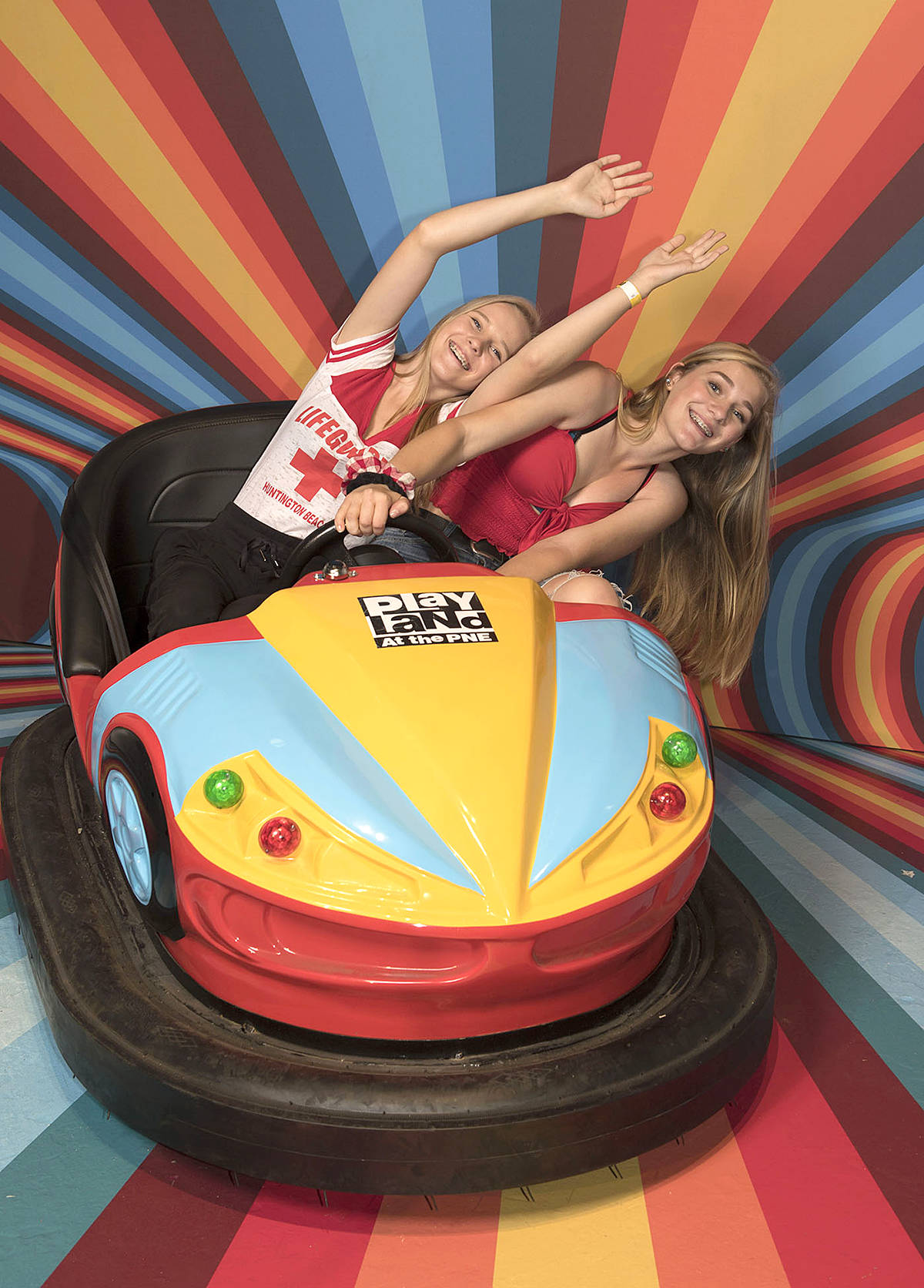 Kennedy Kolisnyk and Isabelle Dyck of Langley brace for impact in a bumper car during their visit to the PNE Fair's Snap Happy exhibit. The massive pop-up pavilion is what social media dreams are made of, open from 11 a.m. to 11 p.m. daily. (PNE/Special to the Langley Advance Times)