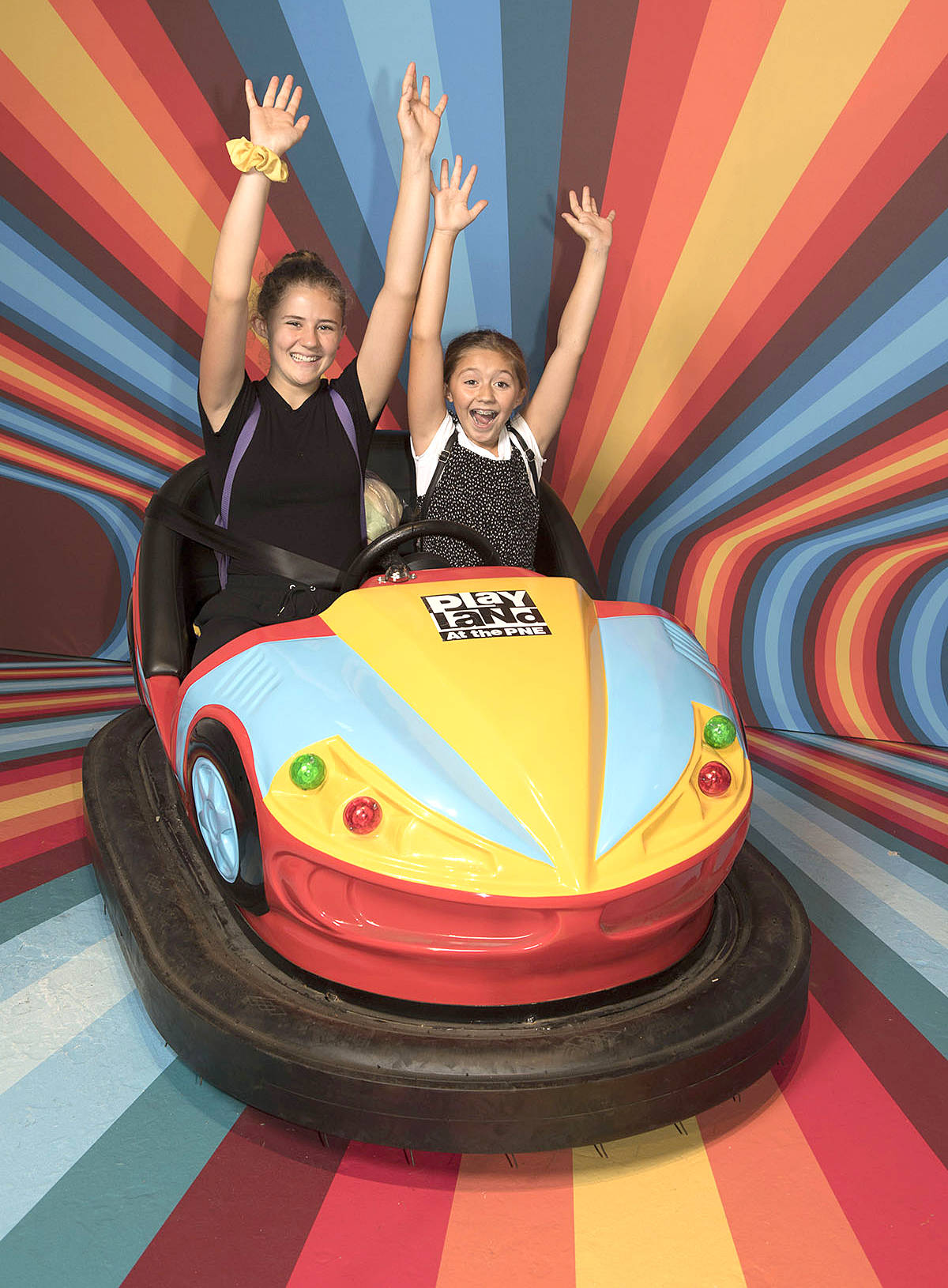 Josephine, 13, and Adrianna Wainwright, 11, braced for impact in a bumper car during their visit to the PNE Fair's Snap Happy exhibit. The massive pop-up pavilion is what social media dreams are made of, open from 11 a.m. to 11 p.m. daily. (PNE/Special to the Langley Advance Times)