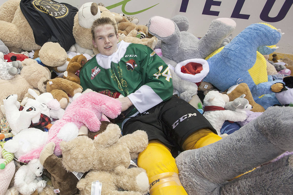 Giants player Bowen Byram and a pile of plush toys that landed during last year's Teddy Bear Toss. (File)