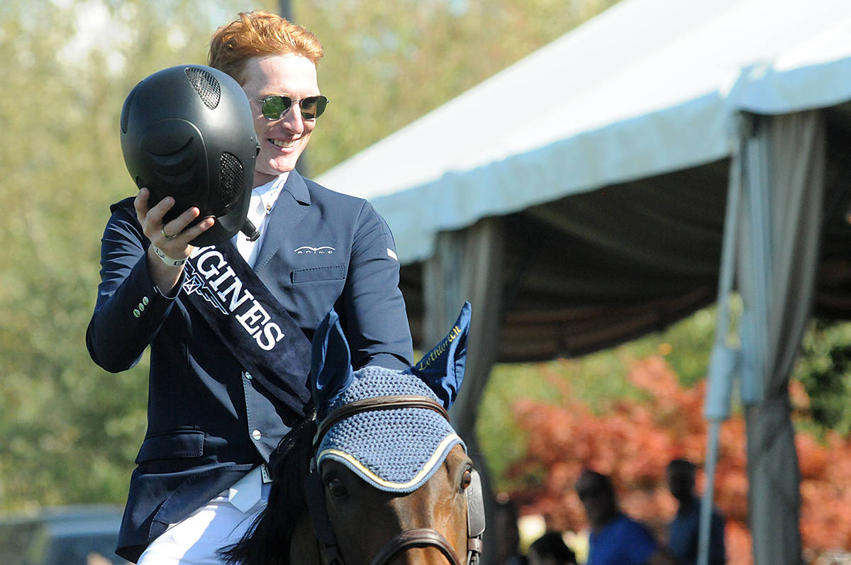 Daniel Coyle waved to the crowd at Thunderbird Show Park in Langley as he took his victory gallop after winning the Longines FEI Jumping World Cup. (Dan Ferguson/Langley Times)