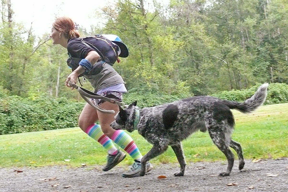 Willa Potter and 'Digger' from Agassiz were among the participants in the first 'Gruesome Twosome' partner run and fundraiser in Aldergrove Regional Park. (Dan Ferguson/Langley Advance