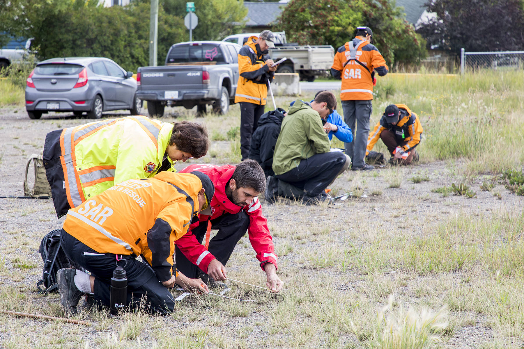 """Aug. 24, 2019 — Nechako Valley Search and Rescue hosted a B.C. tracking association course over the weekend. Members are shown analysing a foot print as part of the introductory course called Track Aware which was guided by Chris Mushumanski. SAR members who already have some track aware courses, were taking the Tracker course which is more advanced. There were trained by Jeni Christie, president of B.C. tracking association. """"In B.C. for search, tracking is a really important skill used on many searches, especially here in the north. Having skilled trackers is really essential in reducing the area you are going to search, finding that subject faster, getting a direction of travel from where they were last seen,"""" Mushumanski said. (Aman Parhar photo)"""