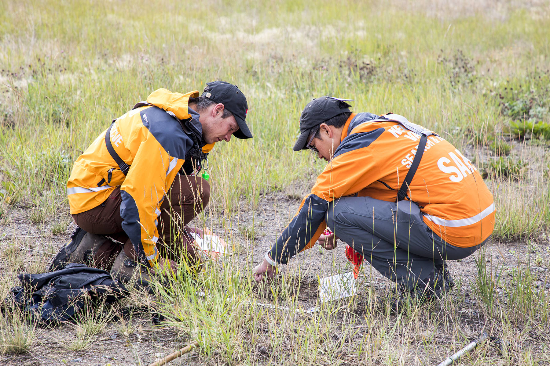 "Aug. 24, 2019 — Nechako Valley Search and Rescue hosted a B.C. tracking association course over the weekend. Members are shown analysing a foot print as part of the introductory course called Track Aware which was guided by Chris Mushumanski. SAR members who already have some track aware courses, were taking the Tracker course which is more advanced. There were trained by Jeni Christie, president of B.C. tracking association. ""In B.C. for search, tracking is a really important skill used on many searches, especially here in the north. Having skilled trackers is really essential in reducing the area you are going to search, finding that subject faster, getting a direction of travel from where they were last seen,"" Mushumanski said. (Aman Parhar photo)"