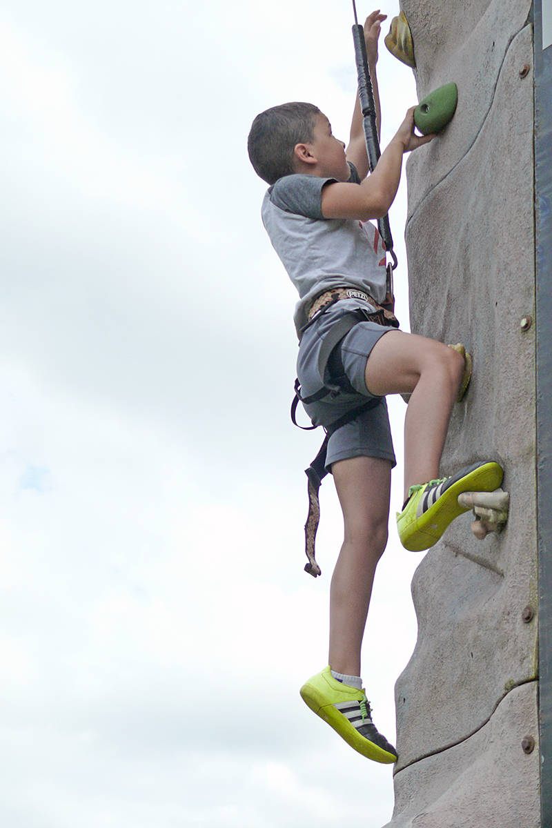 A climbing wall was part of a play area for kids at the second annual Back To School giveaway at Douglas Park Community Schoolon Saturday (Aug. 24). (Dan Ferguson/Langley Advance Times)