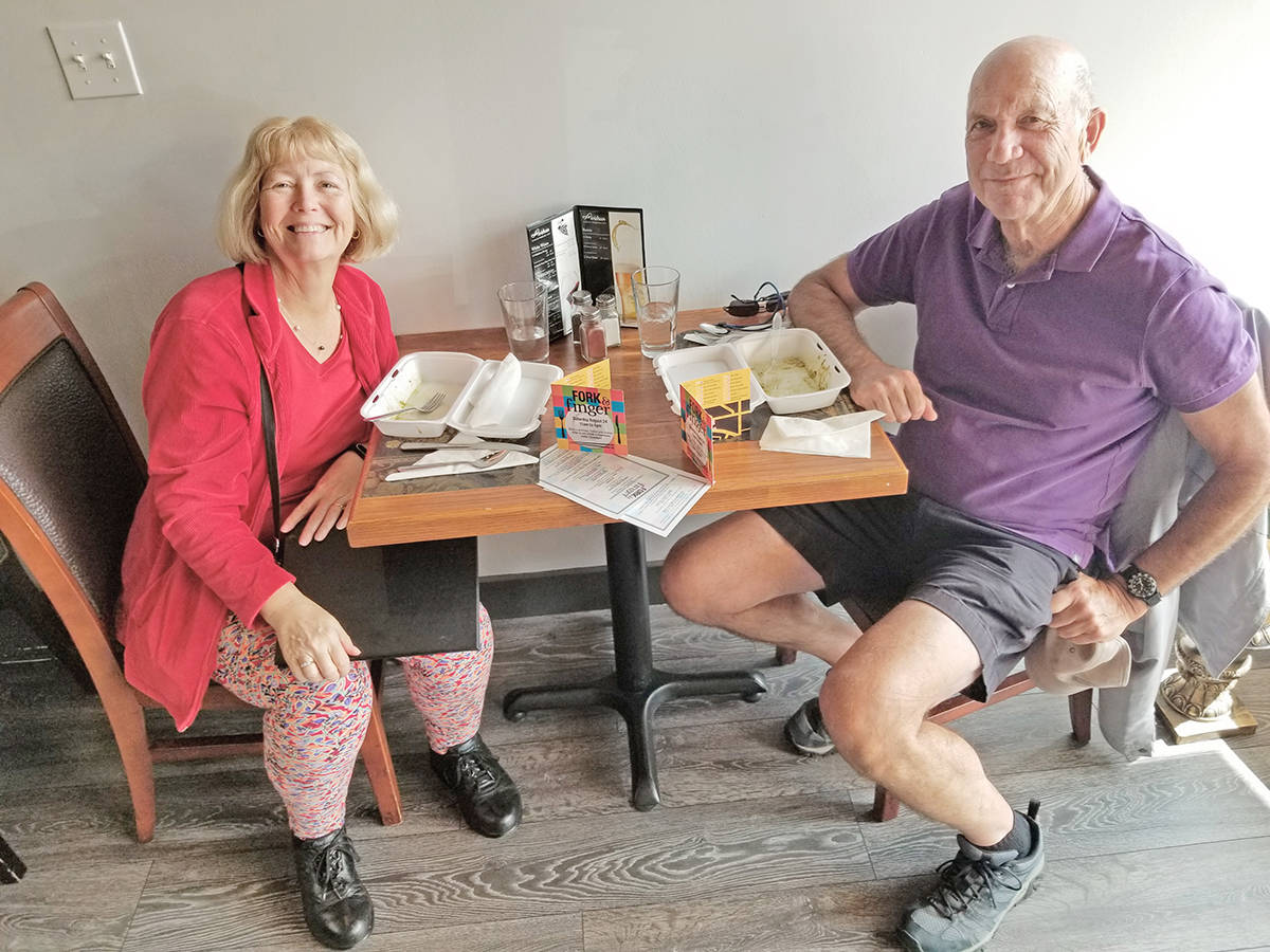 Anne Lavack and George Wellbanks were among the hundreds who sampled offerings from 19 Langley City outlets during the Fork and Finger Event on Saturday, Aug. 24. (Dan Ferguson/Langley Advance Times)