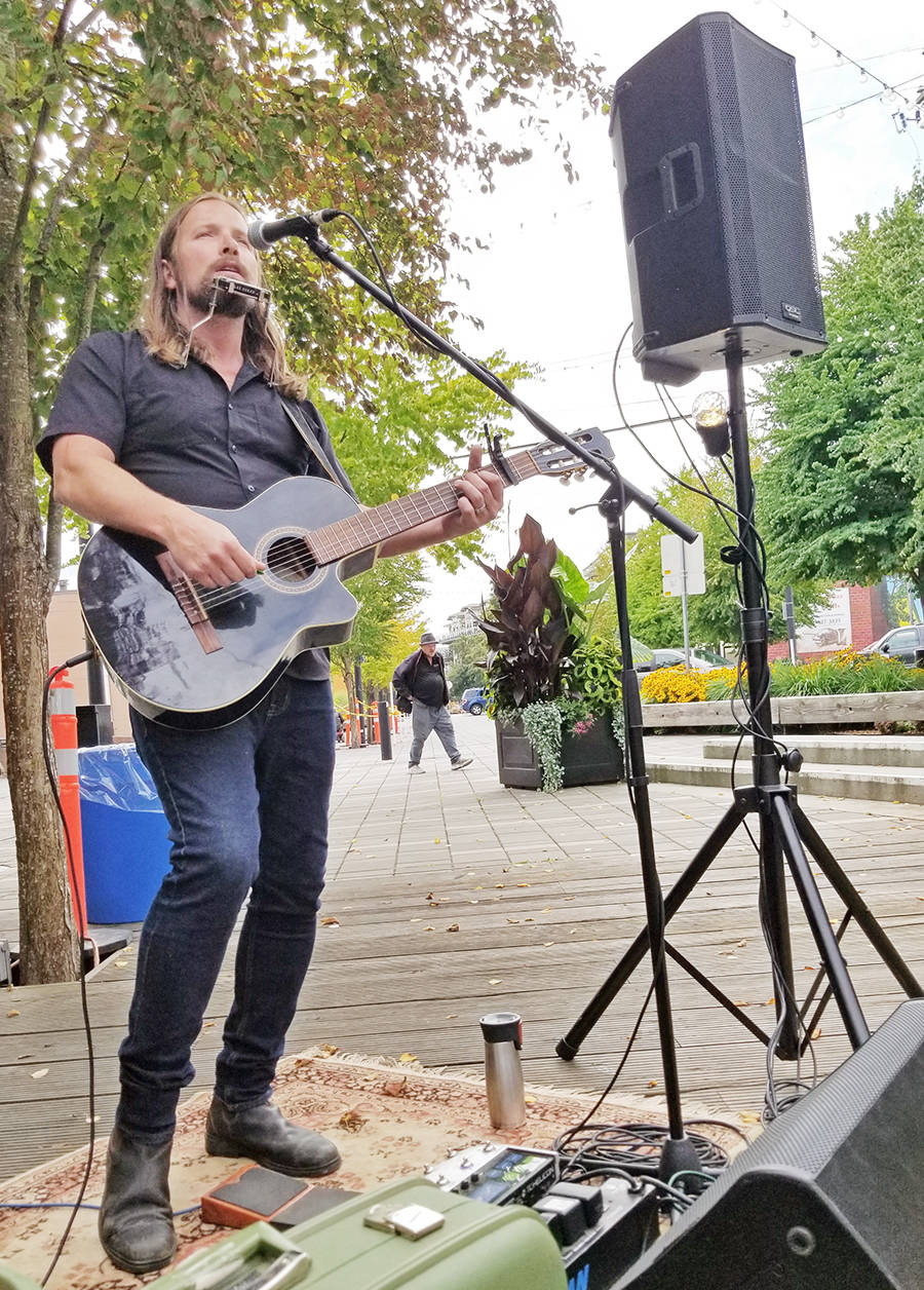 Singer, songwriter, and record producer Ryan McAllister performed live at McBurney Plaza during the Fork and Finger event in Langley City on Saturday, Aug. 27. It was the first of three events that day for McAllister. Dan Ferguson/Langley Advance Times