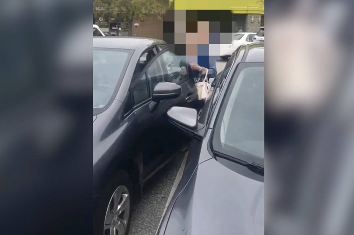A woman was caught on camera on Friday, Aug. 23 where she is heard yelling racial slurs in a parking lot dispute in Richmond, B.C. (Screenshot/Black Press Media)