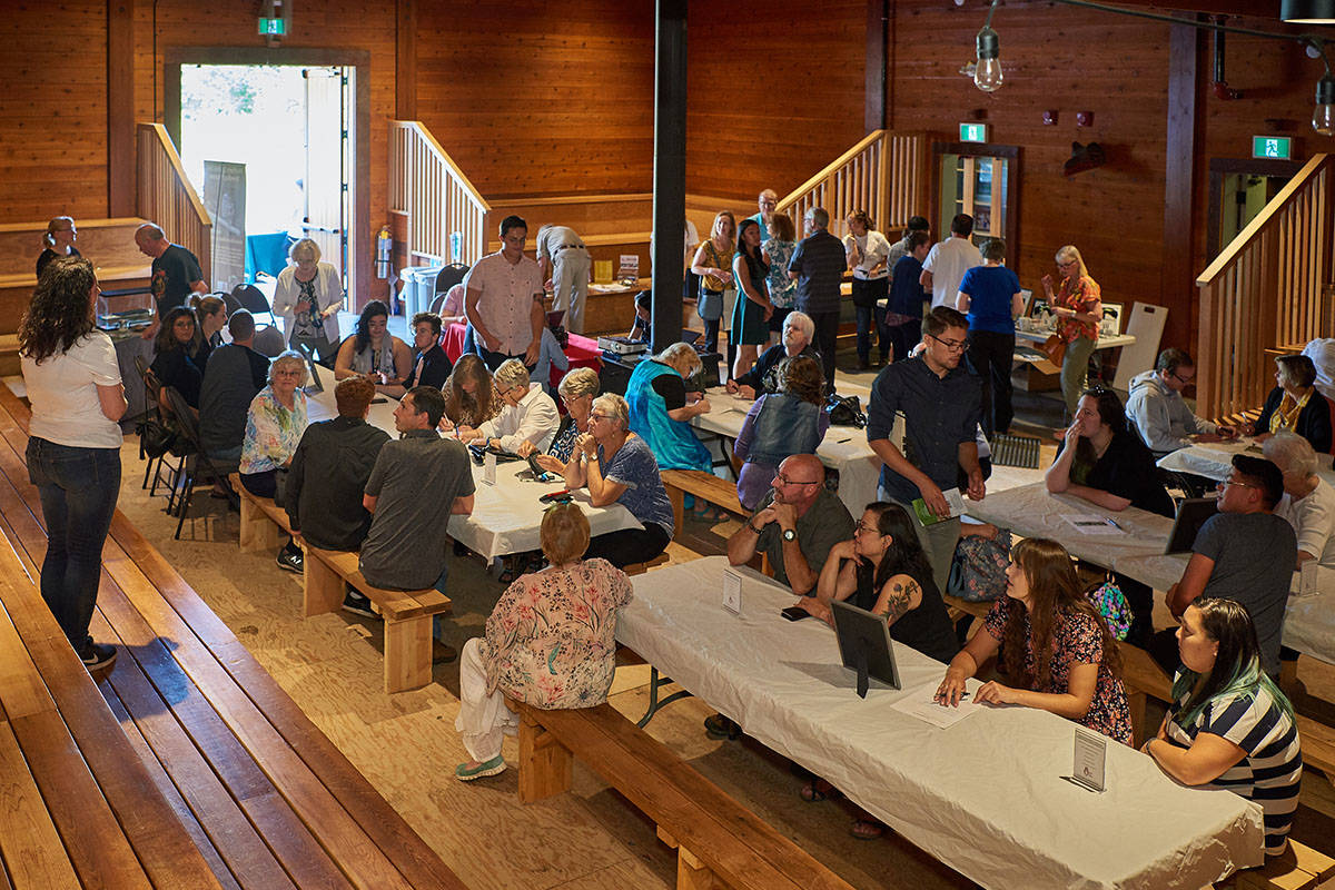 Guests attend a fundraiser at the Kwantlen First Nation Cultural Centre to support the northern spotted owl breeding program on Saturday, Aug. 24. (Jasmine McCulligh/Special to the Langley Advance Times)