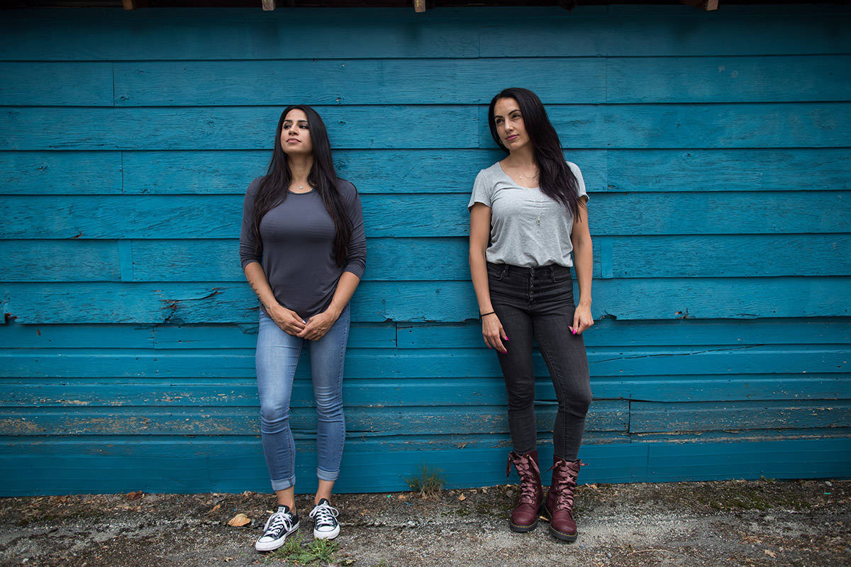 Detective Anisha Parhar, left, and Sgt. Sandy Avelar, who run a program on their own time to try and keep girls out of gangs, pose for a photograph in Vancouver, on Wednesday July 3, 2019. THE CANADIAN PRESS/Darryl Dyck