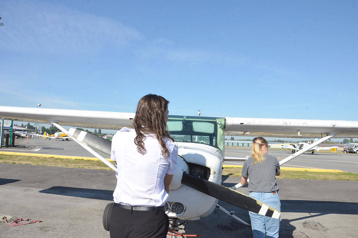 SkyQuest supervising flight instructor Karlee Cindrich and Roberta Grimard moved the Cessna into a parking stall at the Langley Regional Airport where Grimard had just taken a flight as part of the Langley Education Centre's Aviation Explorations 12 program. (Heather Colpitts/Langley Advance Times)