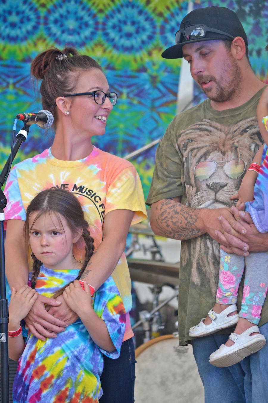 Shelly Bligh, husband Jeff, and their two daughters went on stage to tell the story of their late son and brother, Bentley, who was born premature and required care at BC Children's Hospital. (Krystal Brown photo)