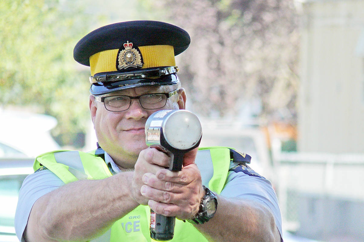 Langley RCMP Cpl. Glen Shippit and his laser speed meter will be looking for drivers going too fast in school zones when classes resume. (Dan Ferguson/Langley Advance Times)