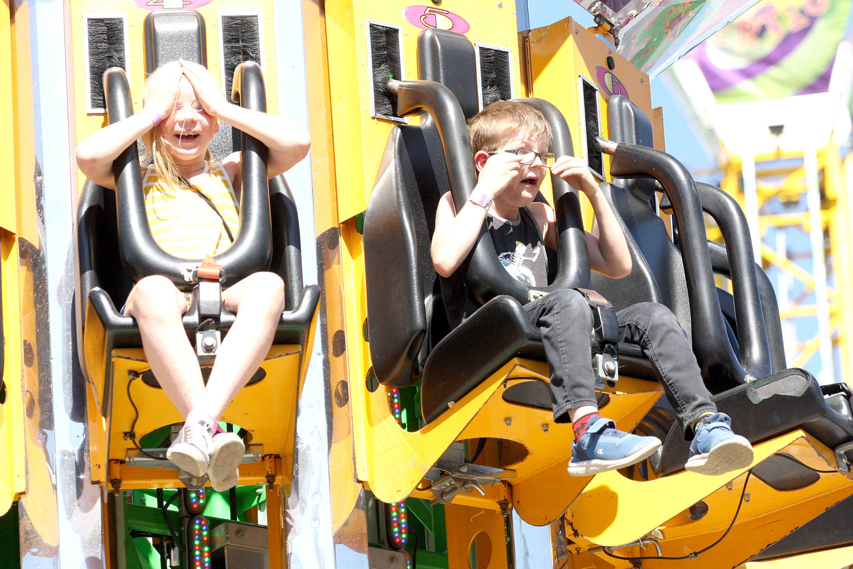 Siblings Kylie and Landyn Pasemko of Vernon go for a thrill ride on the Super Shot at the midway during the IPE in Armstrong, which continues through to Sunday, Sept. 1 (Jennifer Smith - Morning Star)