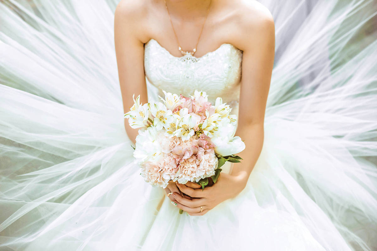 A Cariboo bride could very well be without her uniform this Labour Day weekend after leaving a wedding dress in a box behind a grocery store in 100 Mile House. File photo.