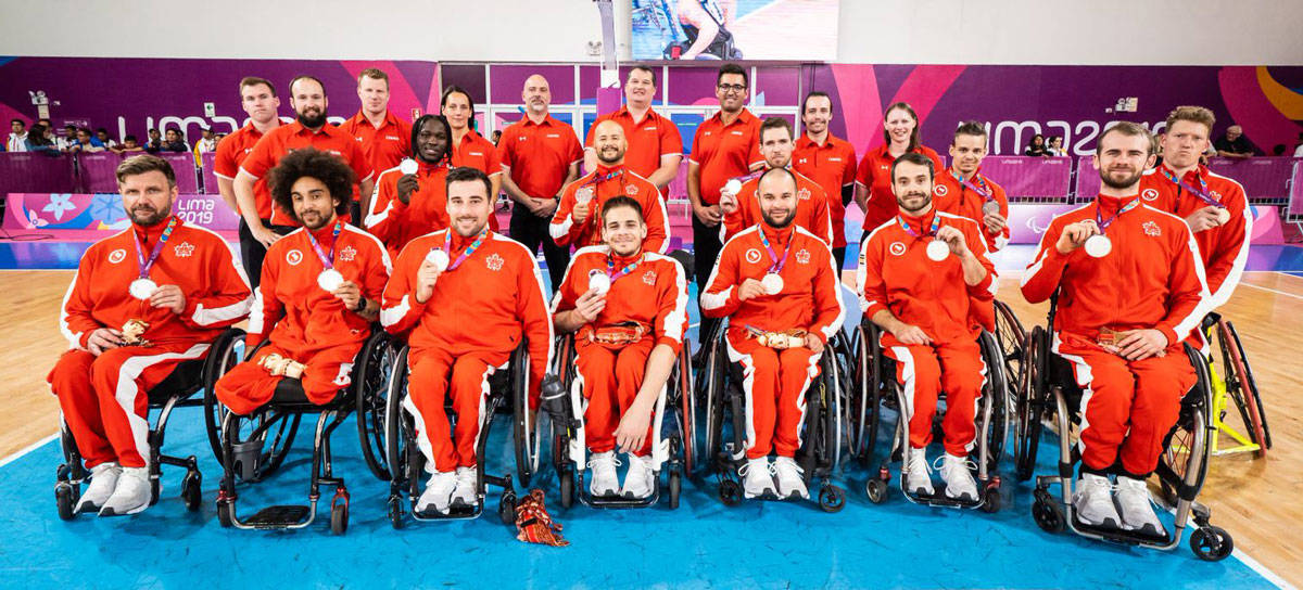 The Canadian men's wheelchair basketball team posed with their silver medals at the Parapan Am Games in Lima, Peru. (Photo via the Canadian Paralympic Committee)