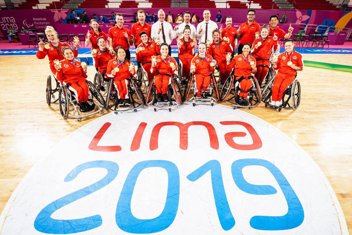 The Canadian women's wheelchair basketball team posed with their gold medals after winning in the finals at the Parapan Am Games in Lima, Peru. (Photo via the Canadian Paralympic Committee)