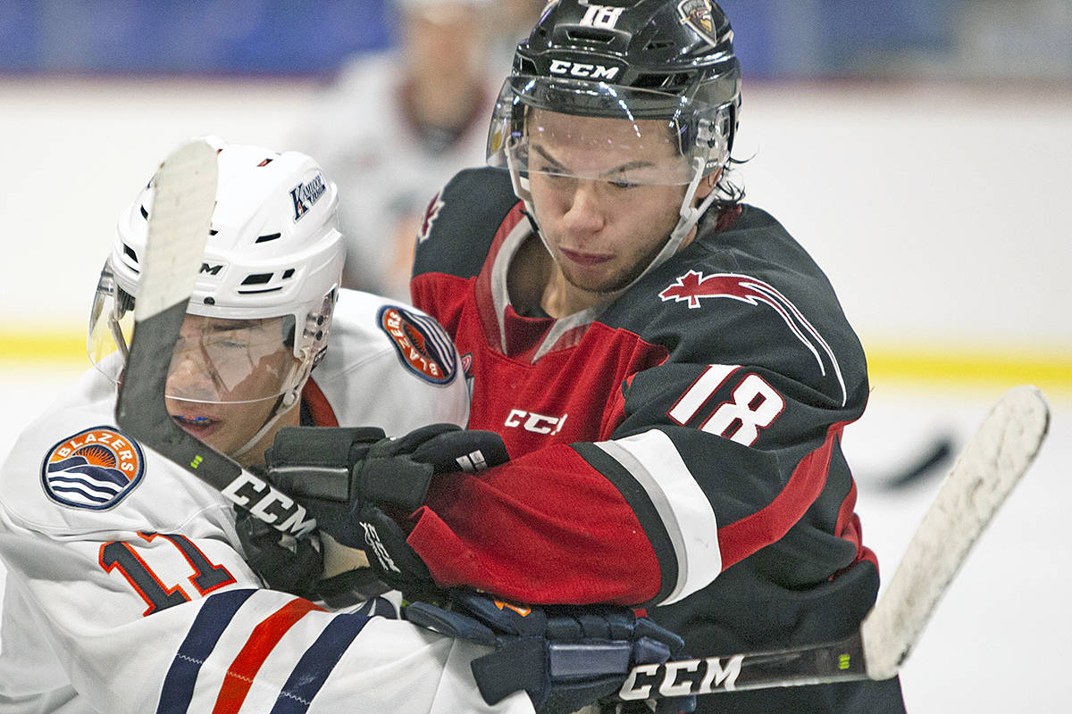 Giants forward Jackson Shepard has a close encounter with a Kamloops player during Sunday's (Sept. 8) game at the LEC (Chris Relke/Special to Langley Advance Times)