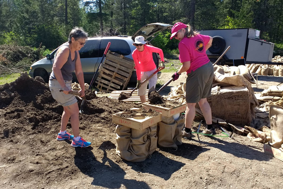 Members of the Kootenay Robusters Dragon Boat team put down their paddles and picked up shovels to help with the sandbagging efforts in Grand Forks and Christina Lake. (Sam Ross photo)
