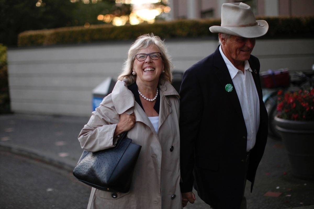 Green Party Leader Elizabeth May arrives with her husband John Kidder before announcing the official launch of the Green Party of Canada election campaign as she's joined by green candidates during a news conference at the Delta Hotels Victoria Ocean Pointe Resort in Victoria on Wednesday, September 11, 2019. THE CANADIAN PRESS/Chad Hipolito