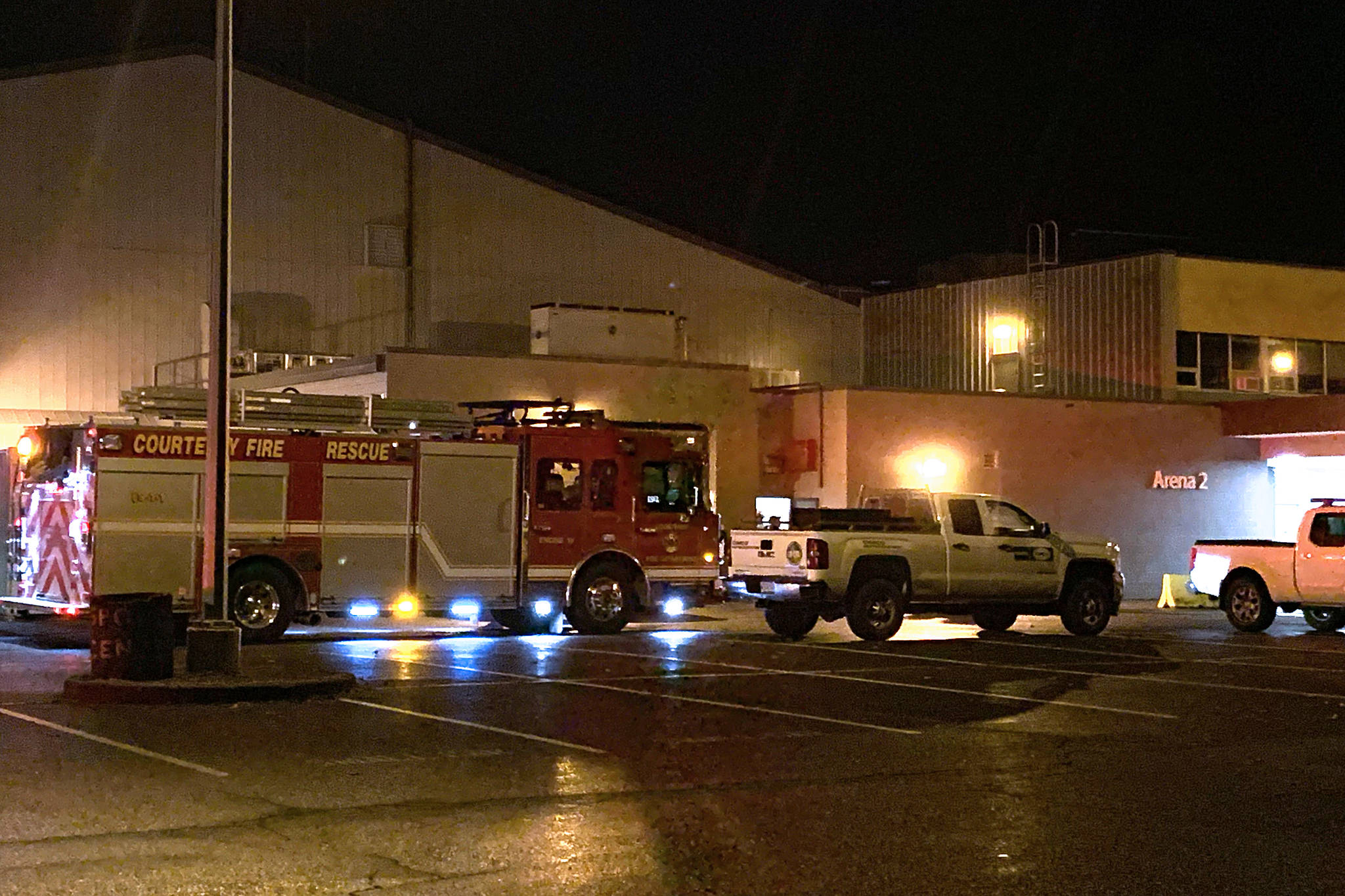 Members of the Courtenay Fire Department assist with an ammonia leak at the Comox Valley Sports Centre on Vanier Drive Thursday evening. Photo by Erin Haluschak