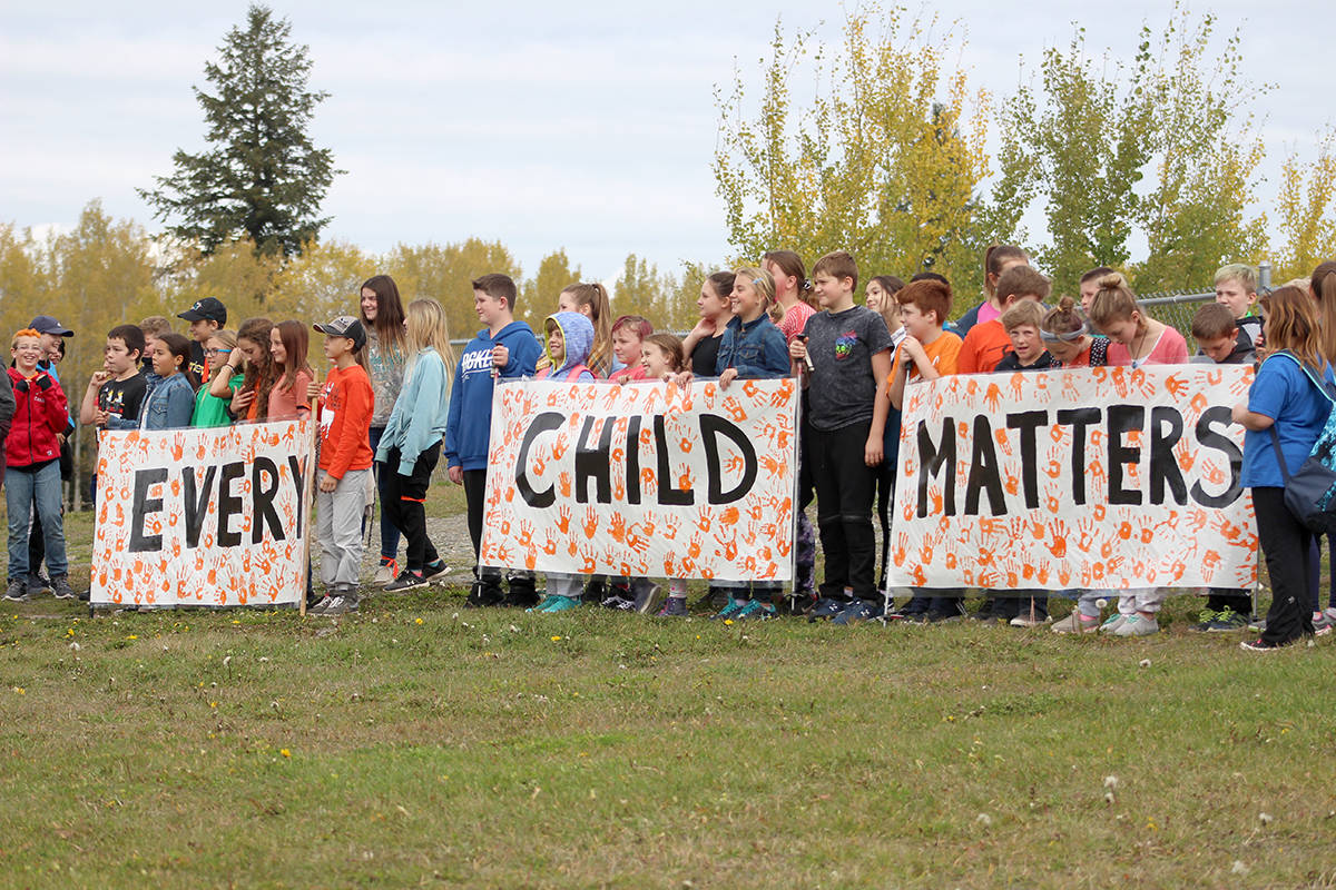 Students of School District 27 hold up signs during Orange Shirt Day outside of the South Cariboo Recreation Centre in 100 Mile House. (Brendan Kyle Jure photo)