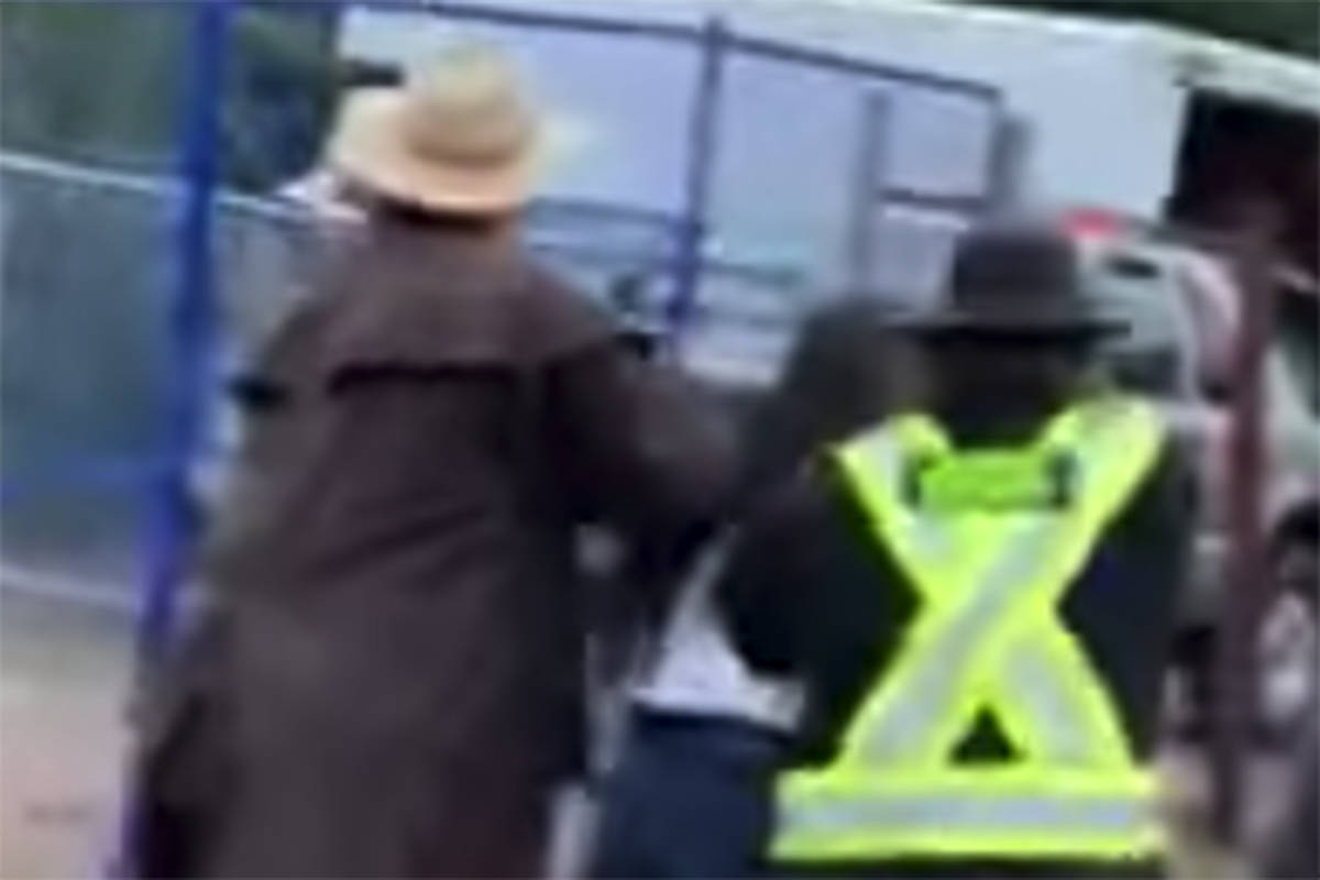 A screengrab of video posted online on Sept. 17, 2019 shows teens being forcibly removed from the Luxton Fairgrounds in Langford on Vancouver Island. (Facebook)