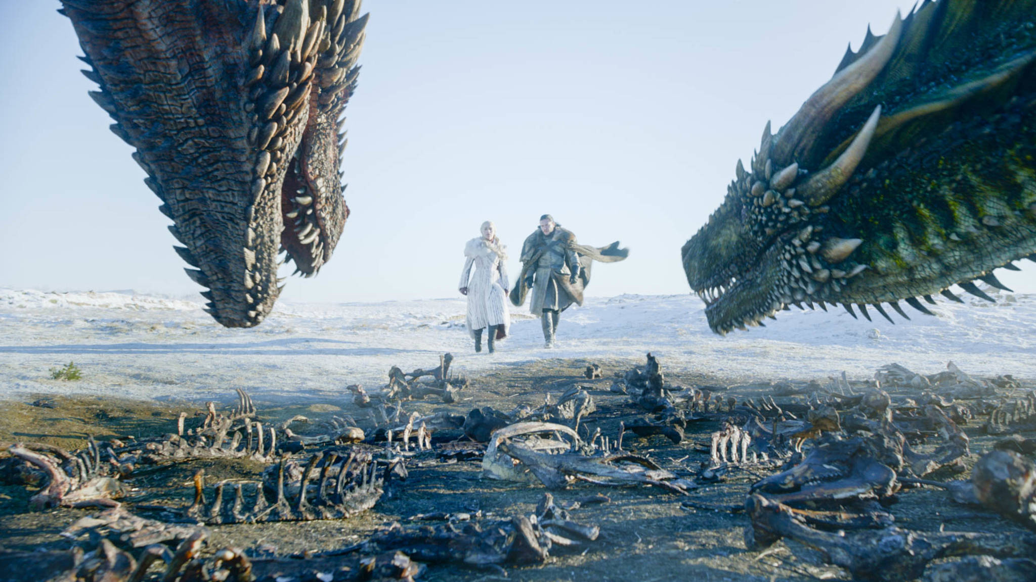"""This image released by HBO shows Emilia Clarke, left, and Kit Harington in a scene from the final episode of """"Game of Thrones."""" (HBO via AP)"""